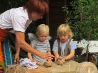 Seamus and children kneading the dough
